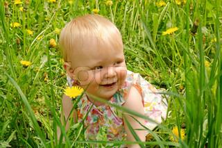 Outdoor portrait of a cute little girl in pink dress