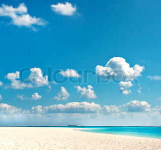 tropical beach with blue sky. travel holiday background