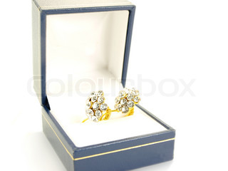 Diamond earrings, isolated in jewelry box towards white