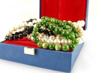 Gemstones in jewelry box towards white