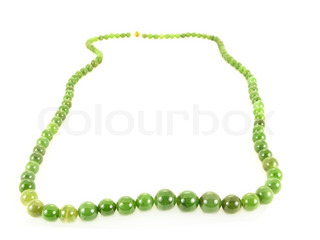 Emerald stone necklace isolated towards white