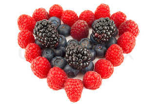 Heart from berries, raspberry, bilberry, blackberry isolated a white background
