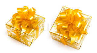 Nice gift packed in golden paper with yellow bow on white background