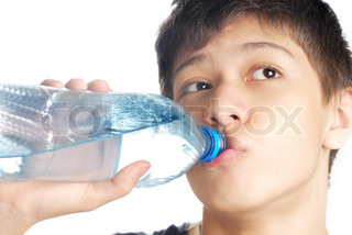 Boy drinking the mineral water after exercise