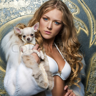 Portrait of the beautiful woman in furcoat with chihuahua