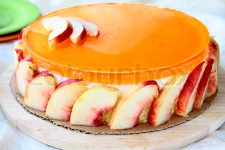 Peach cake with jelly and yoghurt on a plate