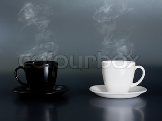 two cup with hot liquid and steam