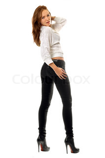 Beautiful girl in black tight jeans. Isolated on white