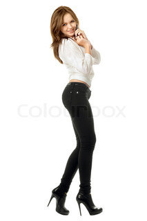 Smiling sexy woman talking on the phone. Isolated