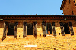 Typical Italian Windows With Open Wooden Shutters