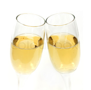 Pair of champagne glasses making a toast