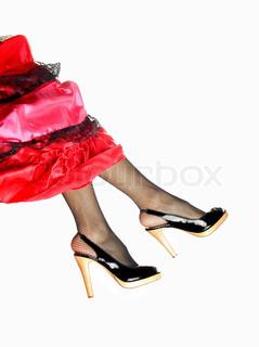 Photo of the elegant legs in Spanish skirt