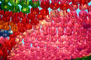 Red and pink paper lanterns in buddhist temple during lotus festival for Buddha's brthday celebration