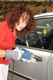 The Elderly Woman Forces the Lock of the Car, Using the Hand Drill.