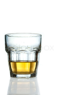 Glass with some yellow drink on white background