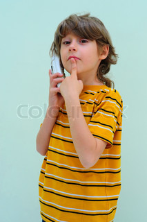 Teen Boy Relax By Talking On Wireless Telephone