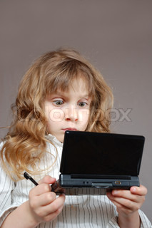 child playing a video game on a mini computer with double screens
