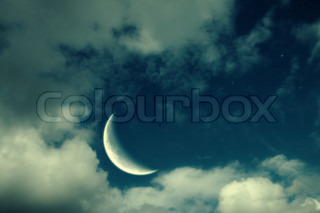 Fantastic night landscape with the big moon, clouds and stars