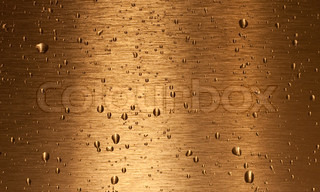 Bronze texture with water drops on it