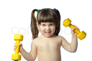 The little girl with dumbbells. It is isolated on a white background