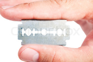 dirty old razor blade in his hand on a white background
