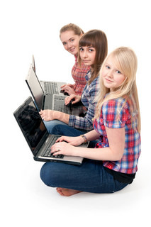 Three girls with laptops sitting in the lotus position