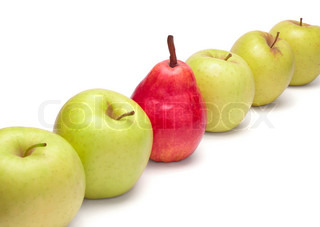 Ripe red pear and green apples in diagonal row