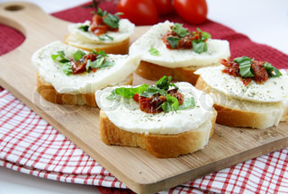 Italian Sandwich with mozzarella basil and tomatoes on the board
