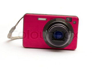 The pink camera isolated on a white background