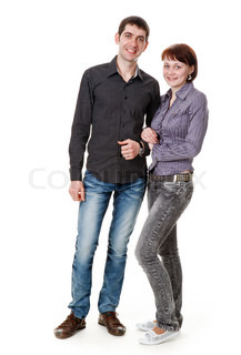 Young woman and man standing on the floor, the girl holds the hand of a guy, isolated on a white background.