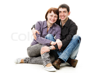 Young woman and man sitting on the floor, a guy hugs a girl, isolated on a white background.