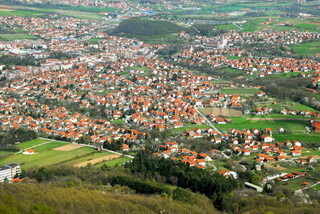 rural landscape of Serbia, meadows and fields with houses red roofs