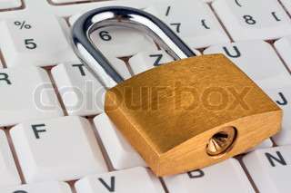 A padlock on a computer keyboard. Data security and protection.