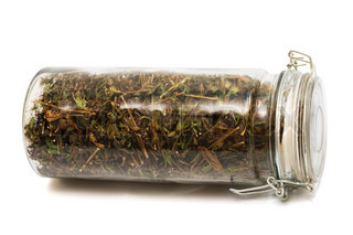 herbs in a jar on a white background