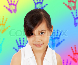 A Shy Young Girl In Her Play Room With Multicolored Hand Prints On The Wall