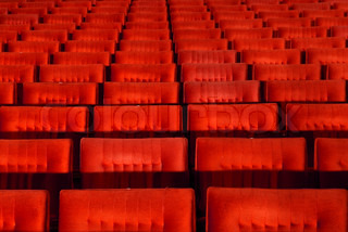 Red concert hall, opera or theatre seats.