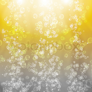 Beer bubbles on a bright gold background with rays of light