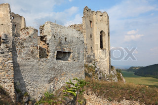 Dilapidated medieval fortress in the spring in Slovakia
