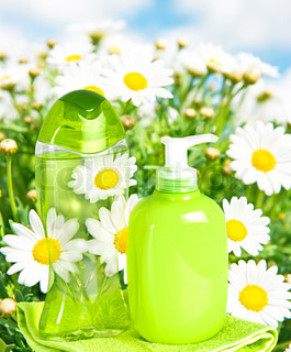 plastic bottle with liquid soap on nature background