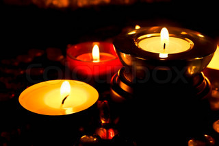 Group of candles against a dark background
