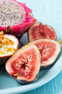 Tropical fruit plate of Figs, Pitahaya and passion fruit.