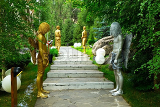 Golden and silver living statue in park