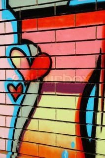 Colorful heart graffiti on a street wall-detail.