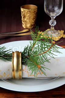 Christmas table setting with a beautiful cloth and snowflake