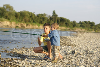 Two brothers fishing on the river
