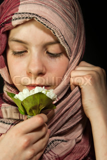 Little girl muffled in a shawl with flowers