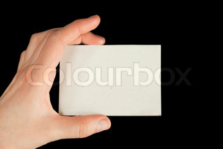 Hand holding a white card isolated on black background