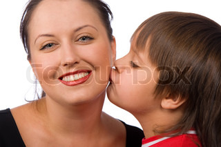 little boy kissing his mother on the cheek