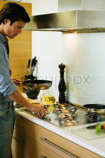 Man cooking on gas stovetop