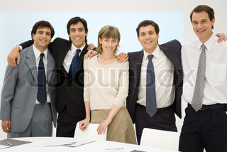 ©Eric Audras/AltoPress/Maxppp ; Business team standing with arms around each other's shoulders, smiling at camera